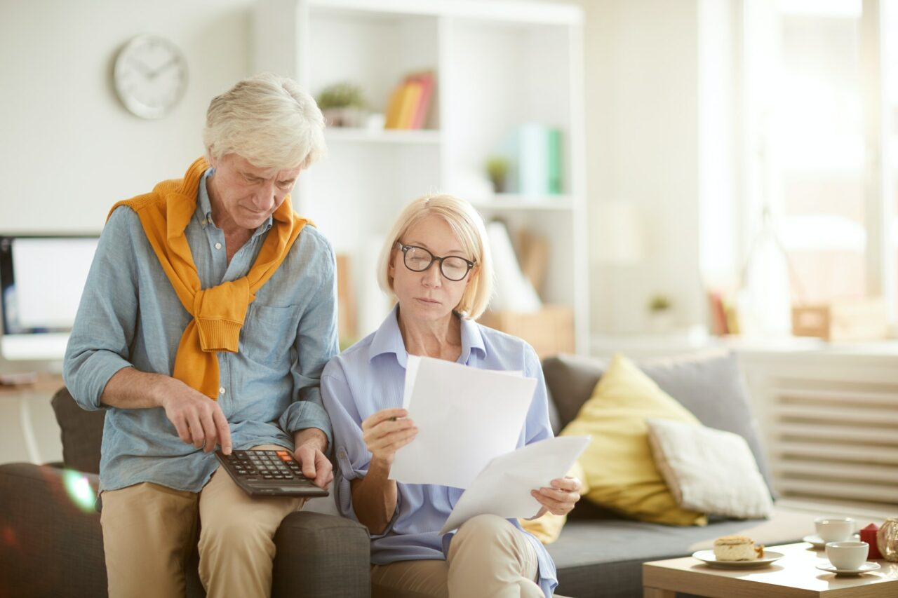 senior couple calculating
